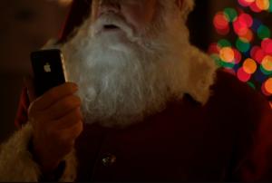 Kerstman met zijn iPhone